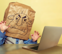 angry person in front of laptop